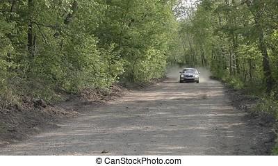 Grey Sedan Saloon Car Running on Forest Dusty Road - Grey...