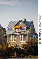 Grey Siding House with Yellow Awning