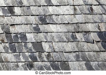 grey slate shingles at the grey wall