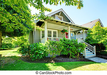Grey small house with porch and white railings. - Grey small...
