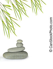 Grey spa treatment stones in perfect balance with bamboo...