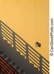 grey step on original yellow wall
