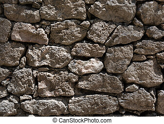 Grey stone wall texture with bright sunlight