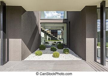Grey villa with terrace