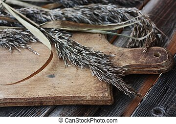 Grey wooden background and rye close up