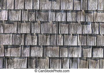 grey wooden shingles at the roof