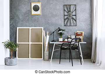 Grey workspace interior with plant