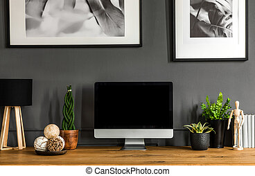 Grey workspace interior with posters