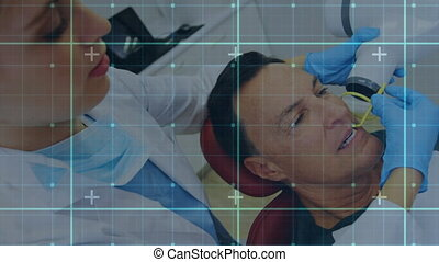 Grid lines against dentist treating male patient - Animation...