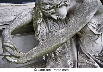Grief - detail of an old marble fombstone at the central...