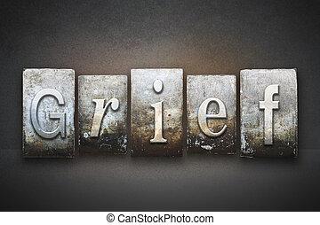 The word GRIEF written in vintage letterpress type