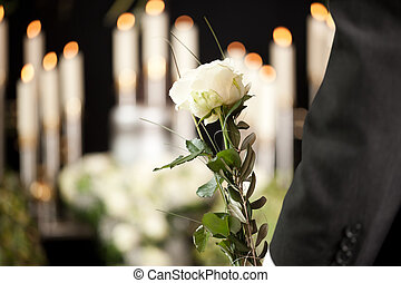 Grief - man with white roses at urn funeral - Religion, ...