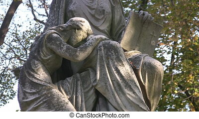 Grief. - Statue of a child, grieving in her mother%u2019s...