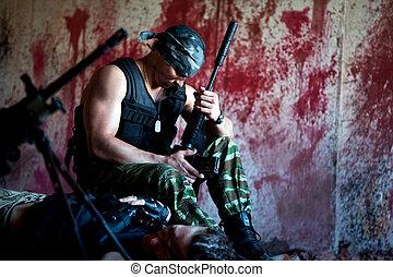 Grief - Mercenary with the gun near a dead body on the...