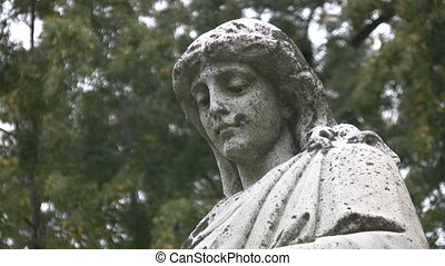 Grieving cemetery statue. - An antique statue in a cemetery....