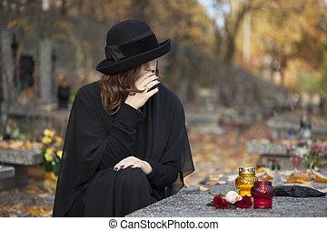 Grieving woman at graveyard - Woman in deep sorrow dressed ...