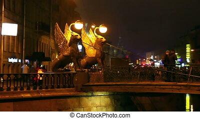 Griffins on Bank Bridge in Saint Petersburg at night