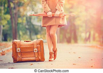 gril, chamarra, park., paraguas, maleta
