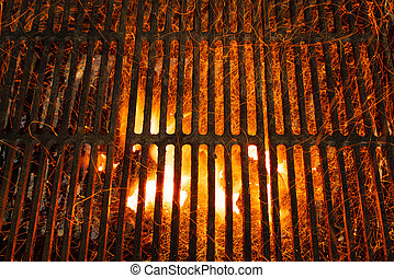 bar-b-cue grill barbecue with red ashes and sparkles in fire