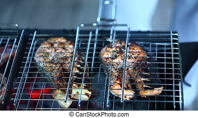 Grill - Fish and beef slices being roasted on a grill.