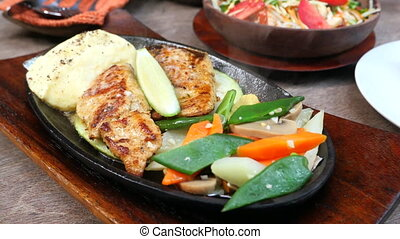 grill fish fillet with fresh salad on plate close up .