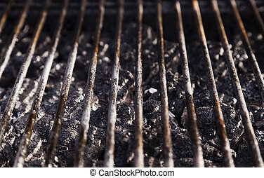Grill Grate and LAva Stones - High angle view of a barbecue...