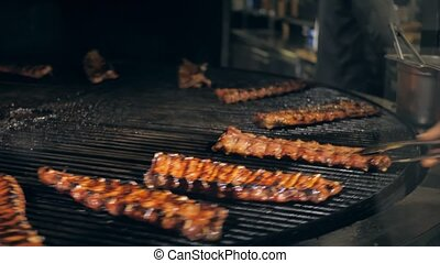 Mixed american barbecue food on hot grill corn being grilled cafe rastaurant meat fire