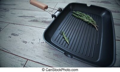 Grill pan with a sprig of rosemary. 4 view points - Empty...