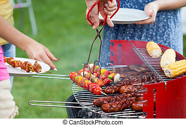Grill party in a garden - Horizontal view of grill party in ...