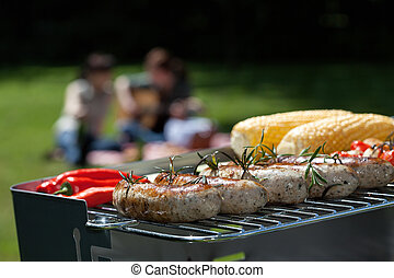 Grill party - A party outdoors with grilled meat and veggies