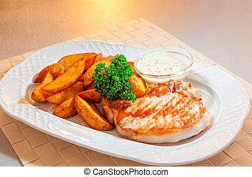 Grill pork and potato wedges with sauce