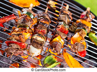 Grill with meat skewers