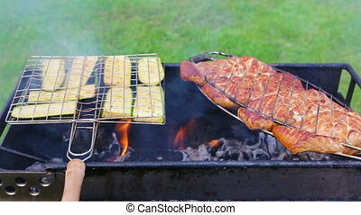 Grill with zucchin and fish. - Fresh healthy green zucchini...