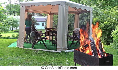 grill wood girl gazebo - nice smoldering wood on the grill....