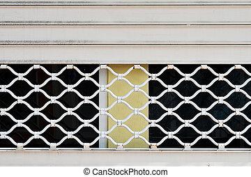 Pattern metal grille gate close-up.