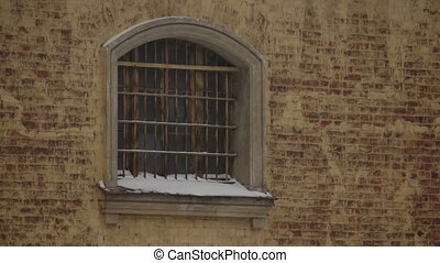 Grille on window of city prison