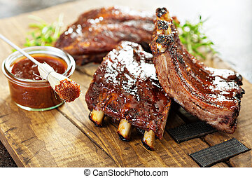Grilled and smoked ribs with barbeque sauce