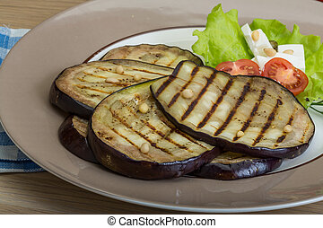 Grilled aubergine with salad leaves and dill