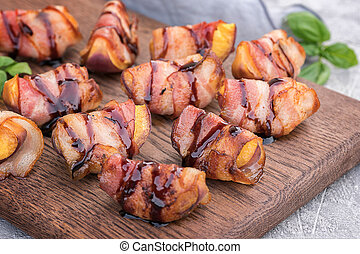Grilled bacon wrapped peach