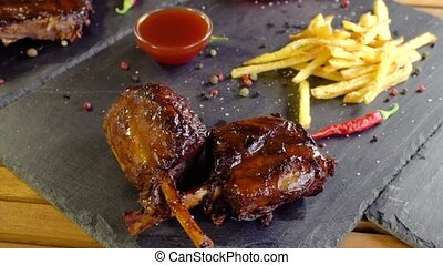 grilled bbq pork meat ribs on stone plate - grilled bbq pork...