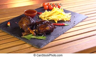 grilled bbq pork meat ribs on stone plate