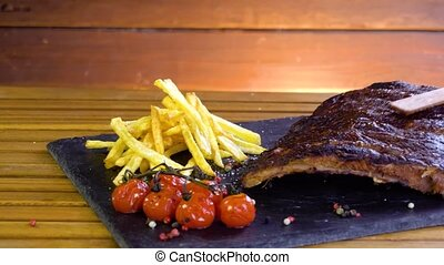 grilled bbq ribs on stone plate - grilled bbq ribs and...
