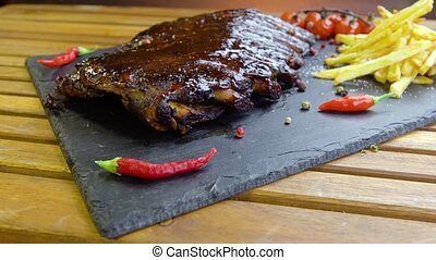 grilled bbq ribs on stone plate