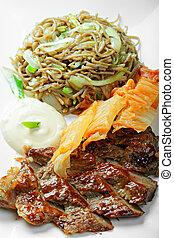 Grilled beaf with noodles above view