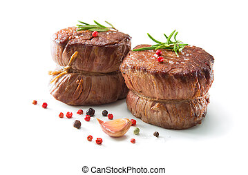 Grilled beef fillet steaks mignon isolated on white background