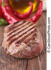 grilled beef on wood