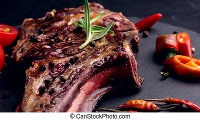 Grilled beef steak on bone with tomatoes