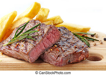 grilled beef steak on wooden cutting board