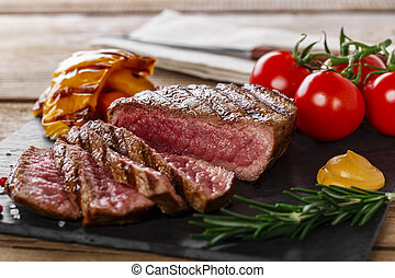 grilled beef steak rare sliced with