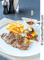 Grilled beef steak with french fried and baked vegetable
